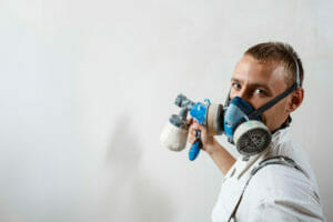 decorator using a paint sprayer
