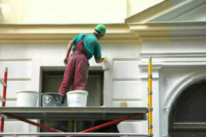 commercial decorator painting exterior of offices